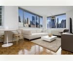 Midtown West: North Facing 1 Bed / 1 Bath with High Ceilings. New Renovation. Blocks from Central Park, Columbus Circle. NO Security Deposit. Low Fee.