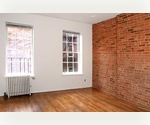 Exposed brick Studio on the upper East Side.