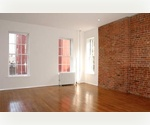 Exposed brick Studio on the upper East Side on Second Ave. Close to trains.