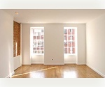 Exposed brick Upper East Side 1 bedroom apartment. Close to 86th street Subway.